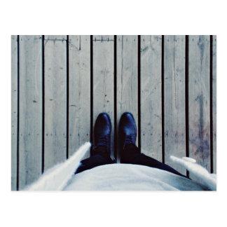 Feet on wooden deck postcard