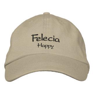 Felecia bordó la gorra de béisbol/el gorra
