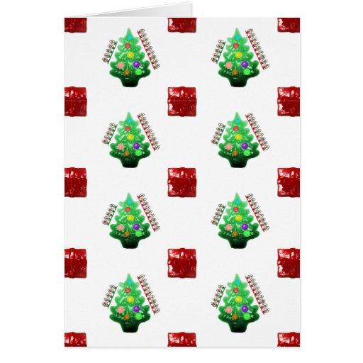 Felices árbol de navidad y regalo tarjeta de felicitación