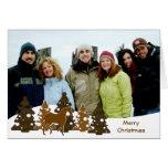 Felices árboles de navidad y caballo felicitación
