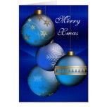 Felices bolas del azul de Navidad de la tarjeta