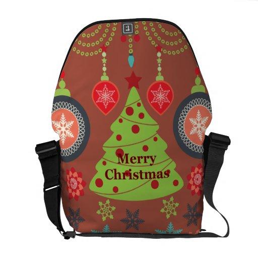 Felices copos de nieve del árbol de navidad del dí bolsa de mensajería