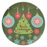 Felices copos de nieve del árbol de navidad del dí platos