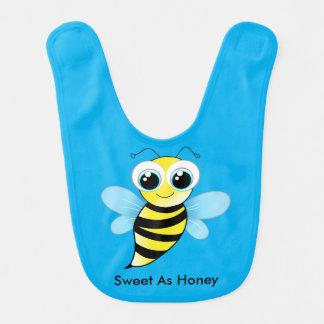 Felices lindos manosean la abeja que el babero