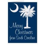 Felices Navidad de la tarjeta azul de la luna del