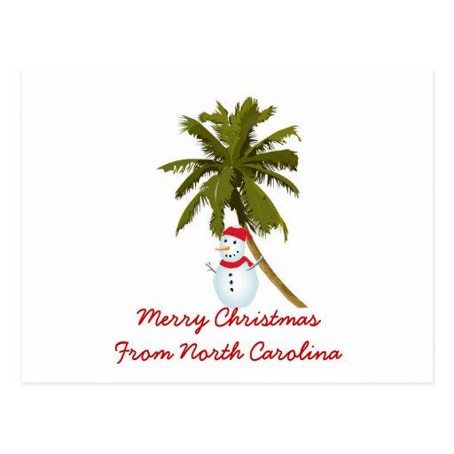 Felices Navidad de N. Carolina, palma del muñeco Postal
