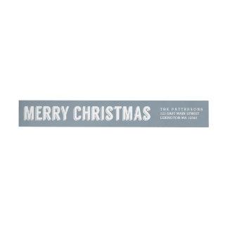 Felices Navidad en etiqueta azul de los saludos