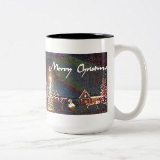 Felices Navidad en taza del esmalte