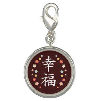 Felicidad en kanji y plumerias dije