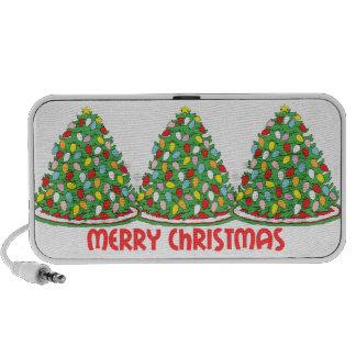 Feliz árbol de navidad con las luces multicoloras notebook altavoz