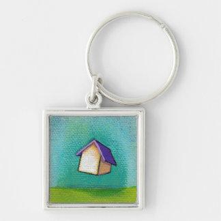 Feliz colorido casero que viaja de la casa del vue llavero cuadrado plateado