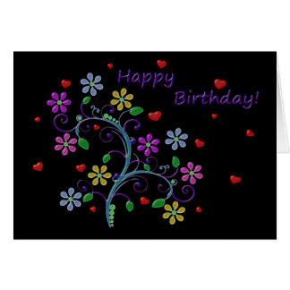 Feliz cumpleaños con las flores, los corazones, y tarjeta de felicitación