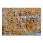 Feliz cumpleaños Tom de la Edad de Piedra Tarjeton
