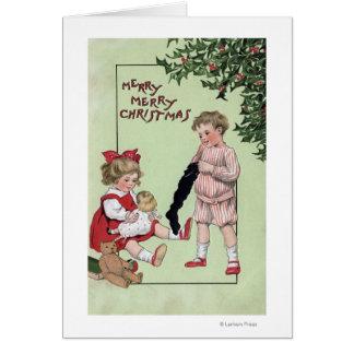 Feliz feliz ChristmasKids con los juguetes por el  Tarjeta