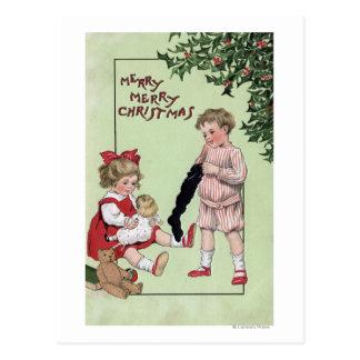 Feliz feliz ChristmasKids con los juguetes por el Postal