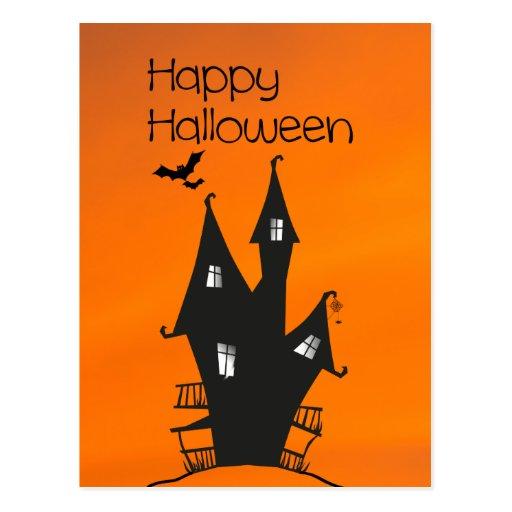Feliz Halloween con una casa frecuentada de las Postales