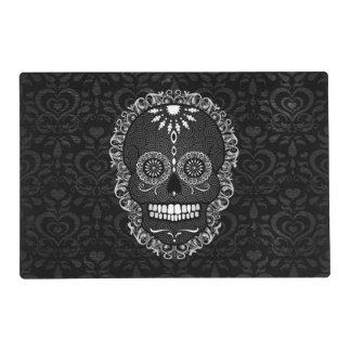 Feliz Muertos - cráneo festivo del azúcar en el Salvamanteles