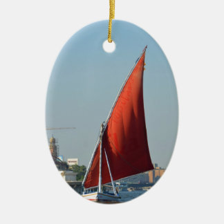 Felucca With Red Sail Double-Sided Oval Ceramic Christmas Ornament