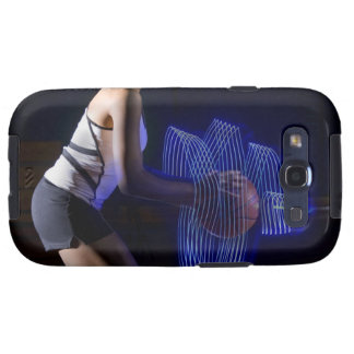 Female basketball player holding ball with galaxy SIII cover