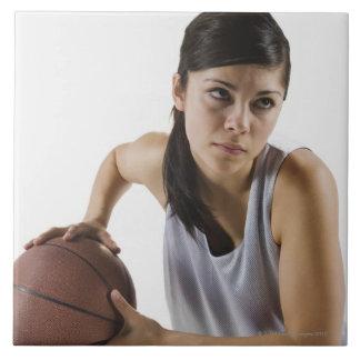 Female basketball player tile