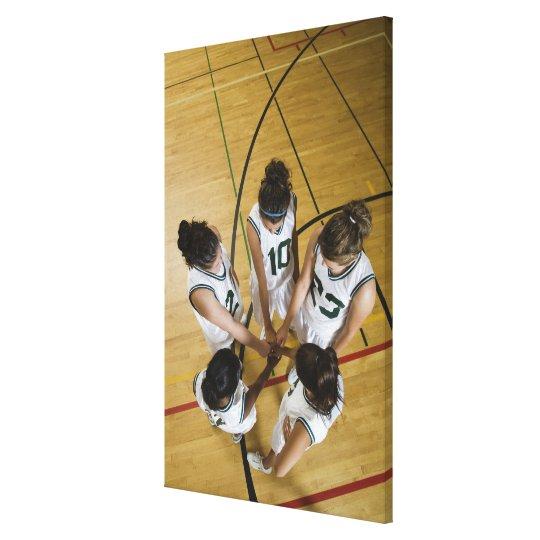Female basketball team having group handshake, canvas print