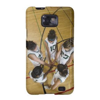 Female basketball team having group handshake samsung galaxy cover