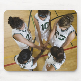 Female basketball team having group handshake, mouse pad