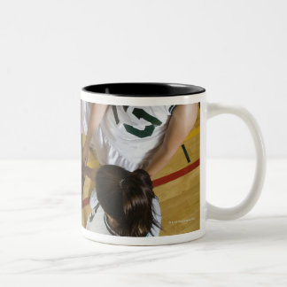 Female basketball team having group handshake, Two-Tone coffee mug
