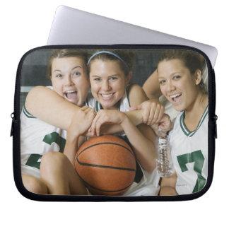 Female basketball team smiling, portrait laptop computer sleeve