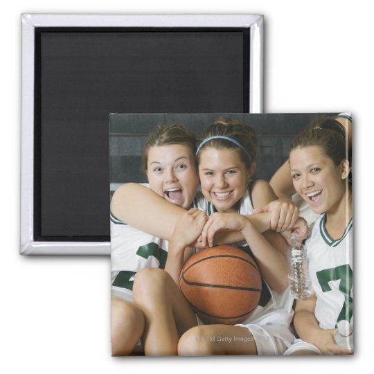 Female basketball team smiling, portrait magnet