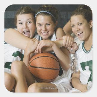 Female basketball team smiling, portrait square sticker