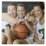 Female basketball team smiling, portrait tile