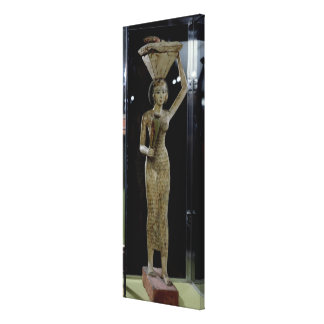 Female bearer of offerings carrying a water canvas prints