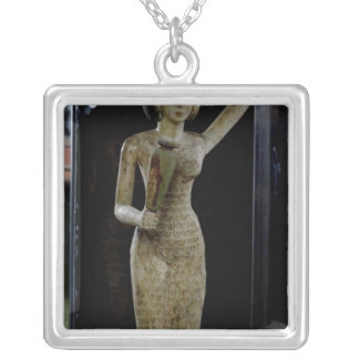 Female bearer of offerings carrying a water square pendant necklace