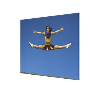 Female cheerleader doing jump splits in air 2 canvas print
