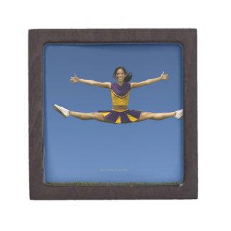 Female cheerleader doing jump splits in air 2 gift box