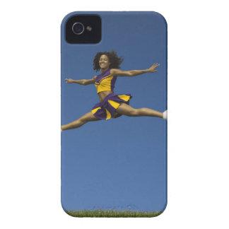 Female cheerleader doing jump splits in air iPhone 4 cover