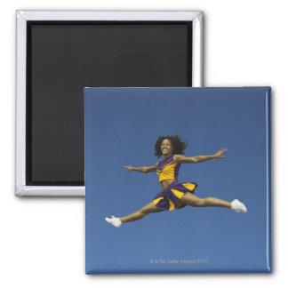 Female cheerleader doing jump splits in air 2 inch square magnet