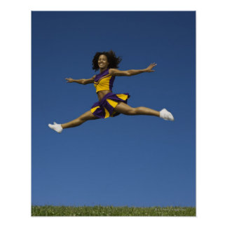 Female cheerleader doing jump splits in air poster