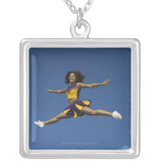 Female cheerleader doing jump splits in air silver plated necklace