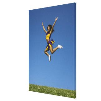 Female cheerleader jumping in air 2 canvas print