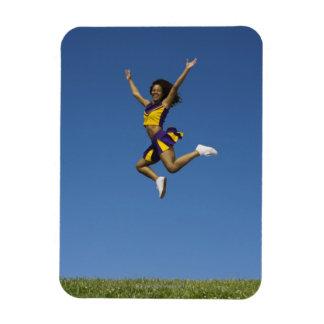 Female cheerleader jumping in air 2 magnet