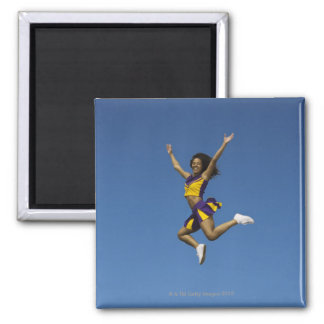 Female cheerleader jumping in air 2 2 inch square magnet