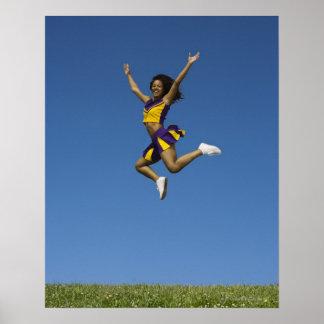 Female cheerleader jumping in air 2 poster