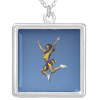 Female cheerleader jumping in air 2 silver plated necklace