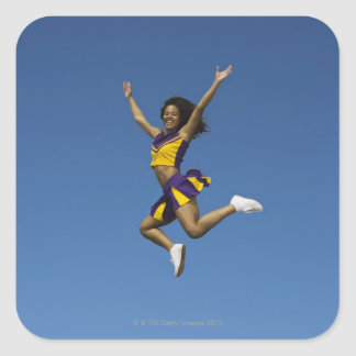 Female cheerleader jumping in air 2 square sticker