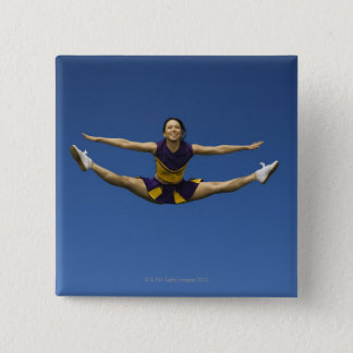 Female cheerleader jumping in air 3 button