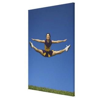 Female cheerleader jumping in air 3 canvas print