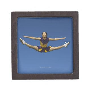 Female cheerleader jumping in air 3 gift box
