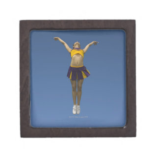 Female cheerleader jumping in air, front view keepsake box
